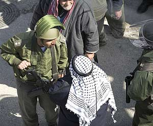 Isreali soldier and Palestinian man