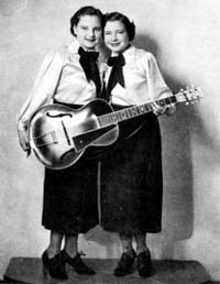 Photo of Cackle Sisters and guitar