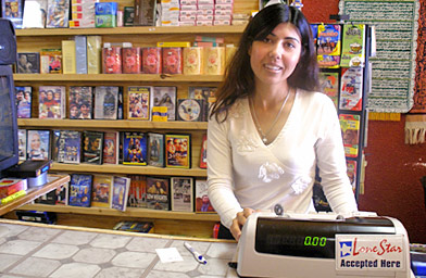 Mariya Sher Ali behind the counter of her store, Amarillo International Foods.