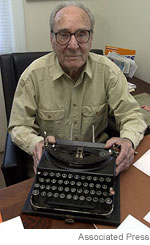 AP Photo: Bill Heinz at typewriter