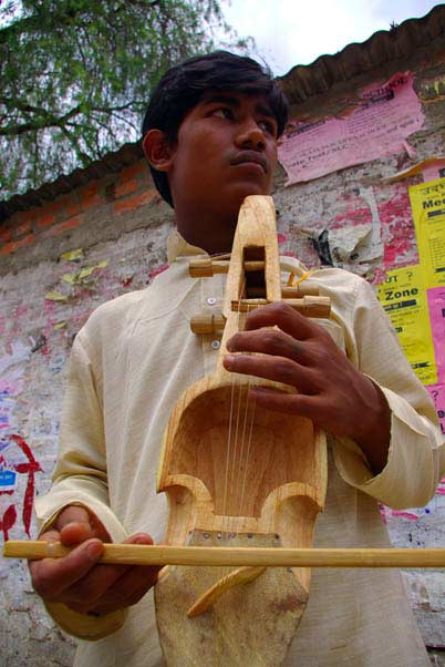 Rubin Gandharba playing sarangi