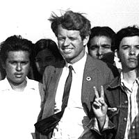 Robert Kennedy with Chicano activist Harry Gamboa flashing a peace sign