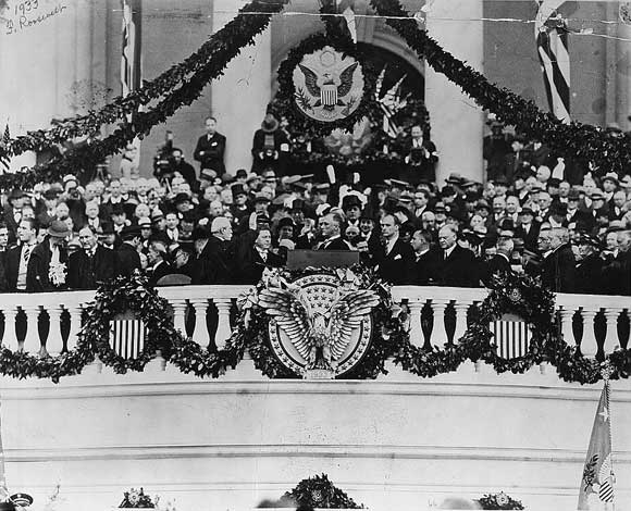 Chief Justice Charles Evans Hughes administering oath of office to Franklin Delano Roosevelt on the east portico of the U.S. Capitol, March 4, 1933