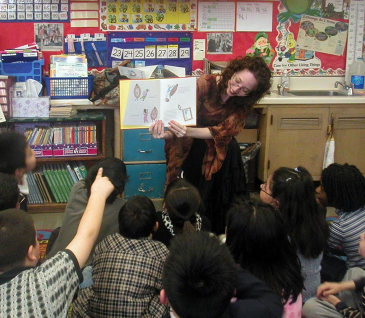 Esme Codell reading and showing pictures to school children