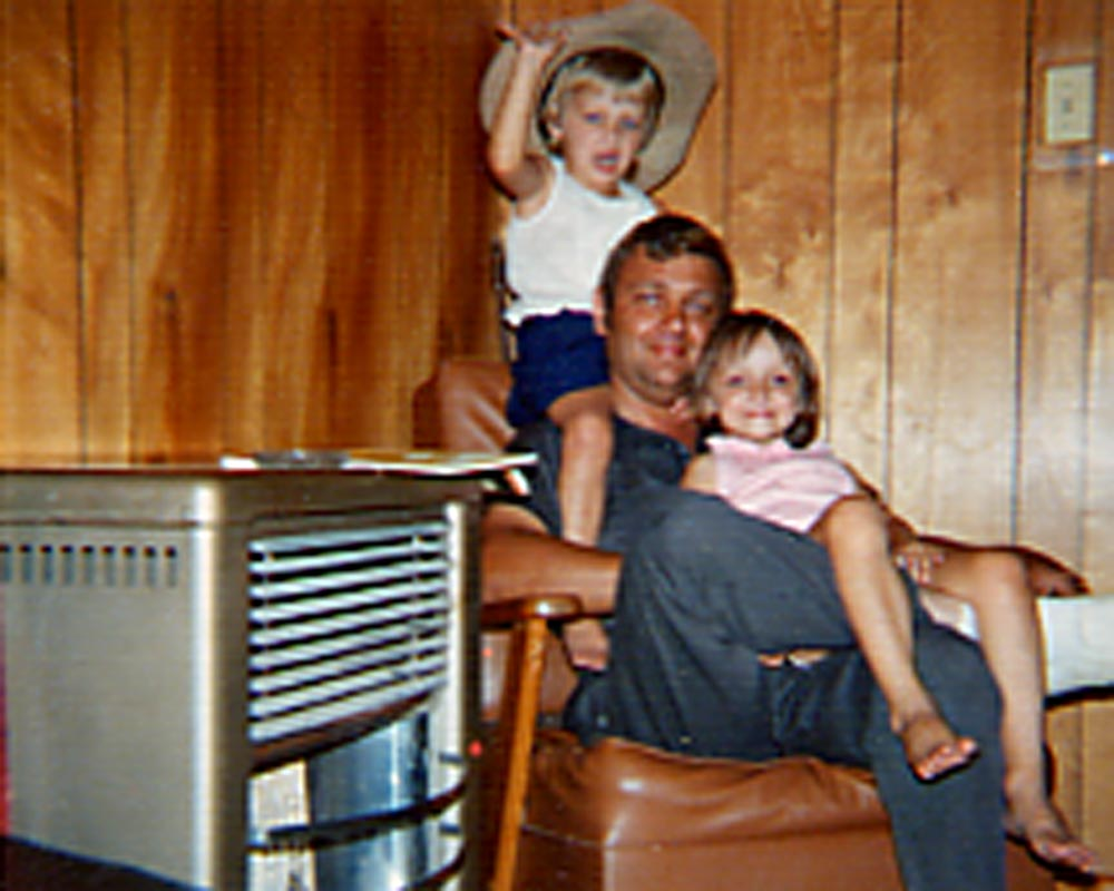 Pat Vowell with daughters Sarah and Amy in family den