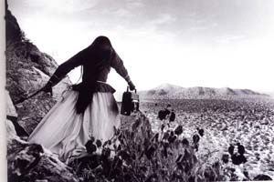 Girl in dress in desert
