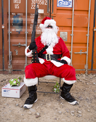 Santa with shotgun defending his gifts. He's serious.