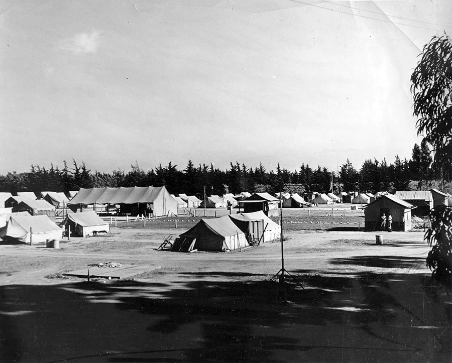 Migrant camp tents, wide shot