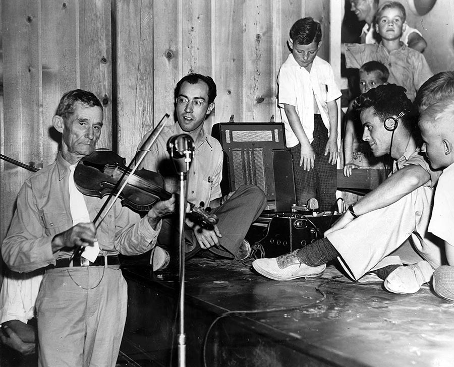 Will Neal playing fiddle being recorded by Charles Todd and Robert Sonkin