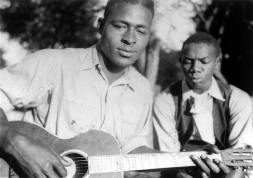 Guitarist Gabriel Brown with Rochelle French, Eatonville, Florida 1935; Alan Lomax, photographer