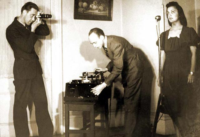 Robert Cook (with camera) and Stetson Kennedy (with recording equipment) documenting Edith Ogden-Aguilar Kennedy, Ybor City, 1939
