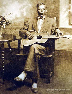 Charley Patton and guitar