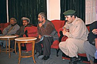 General Dostum (center) meeting in Sherbigan