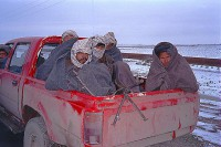 Northern Alliance soldiers in Toyota pickup driving the road from Mazur to Shrerbigan
