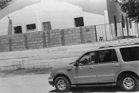 A young boy in the smuggling trade driving a new Ford Expedition (photo: Julián Cardona)