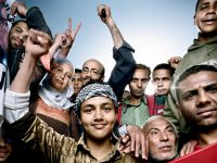 Tahrir Square protesters, rerunning to Tahrir Square, April 1, 2011, photographed by Platon