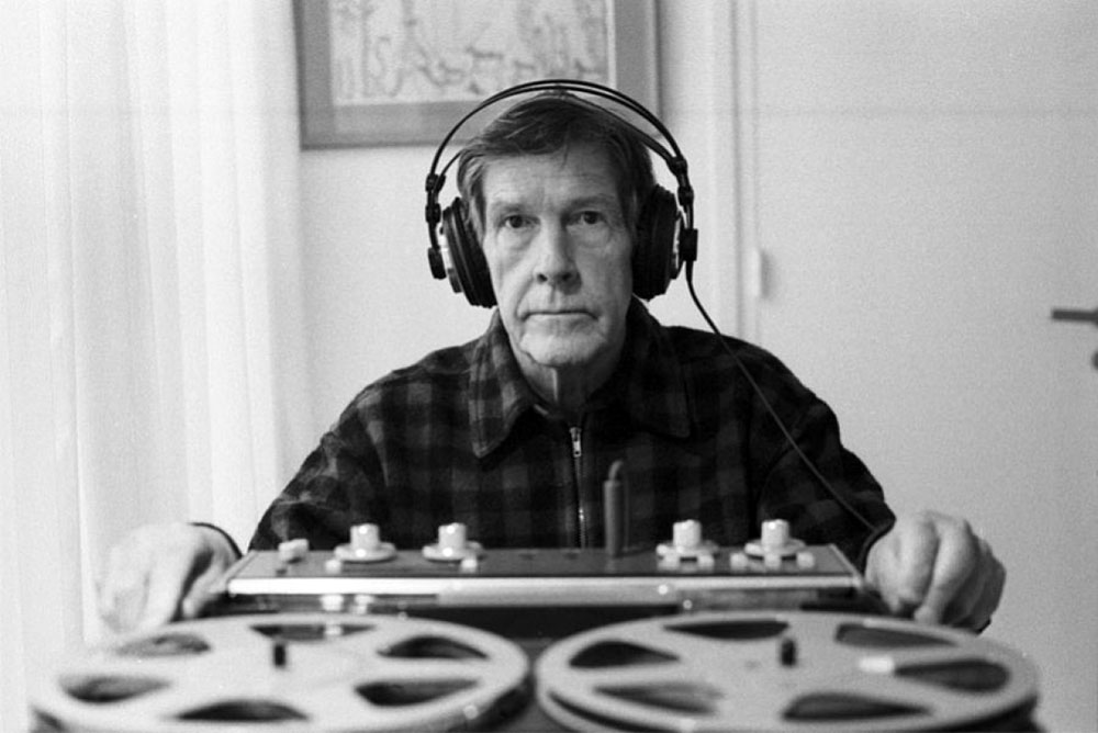 John Cage with headphones and tape recodrer, 1981