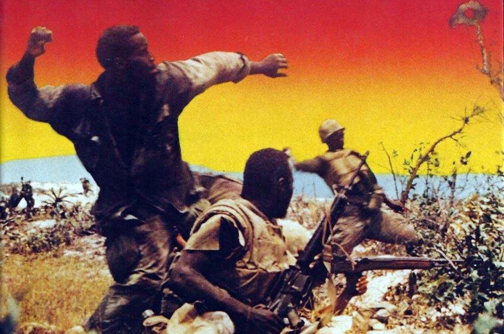 African American troops in combat in Vietnam.