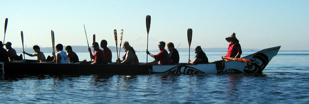 Native americans in canoe along the Tribal Journey route.