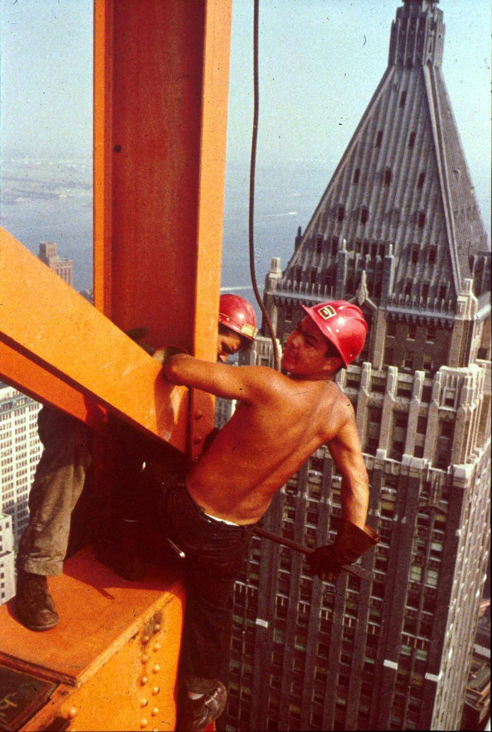 Joe Regis (Kahnawake Mohawk Territory) hovers over New York while working on the Chase Manhattan Bank Building in 1960
