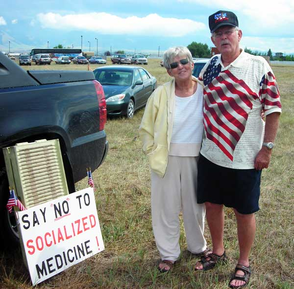 Couple with anti-socialized medicine sign