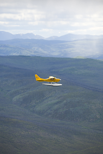 Sea plane over Yukon mountains and river