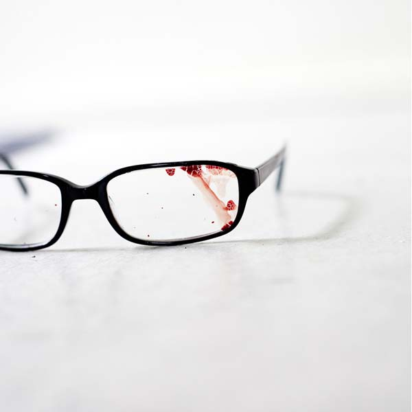 Jake's eyeglasses with blood on them