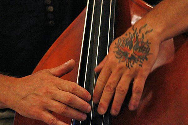 Kelly Roberti, hands, tatoo, bass