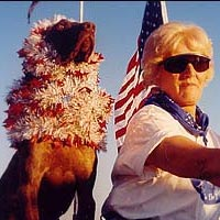 Dog and woman in flags on motorcycle
