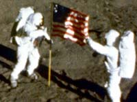 Apollo 11 deploys the U.S. flag on the Moon, July 20 1969
