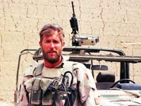 Sgt. Clint Douglas and armed Army jeep