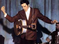 Elvis, with guitar and gyration, live at the Louisiana Hayride
