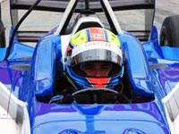 Driver in an open-wheel, open-cockpit Champ Car.