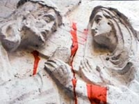 Jesus and Mary with red paint, sculptural relief on a Jerusalem building, photo by Jake Warga