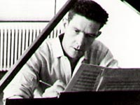John Cage composing at piano