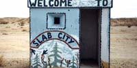 Hut with Welcome to Slab City sign