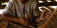 A student learning to play the Thana in Mae La refugee camp