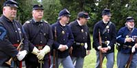 Civil War re-enacters in uniform and armaments