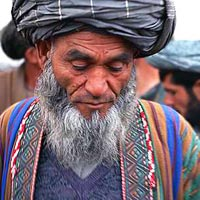 Elder Afghan gentleman, detail of photo by Scott Carrier