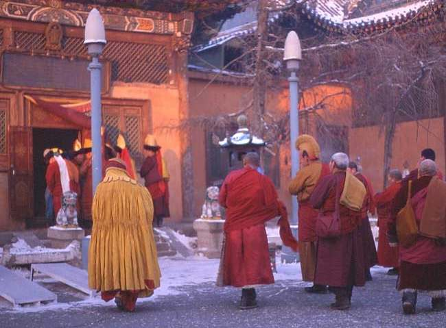 Monks walking into Monastery
