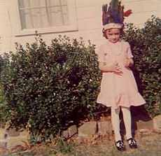 Sarah as a child in Indian headdress
