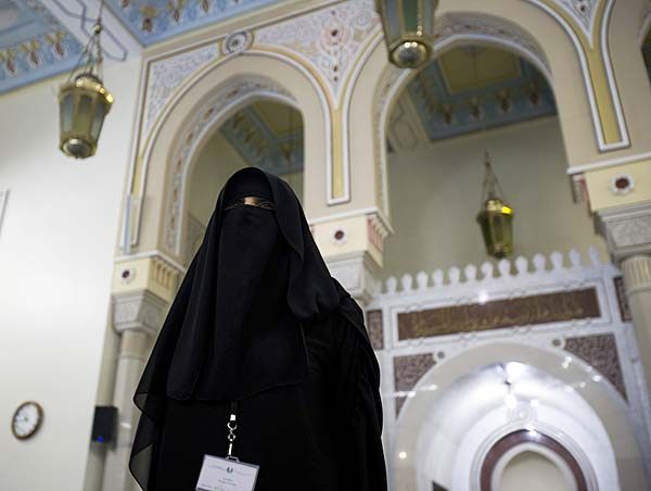 Woman in veil inside mosque