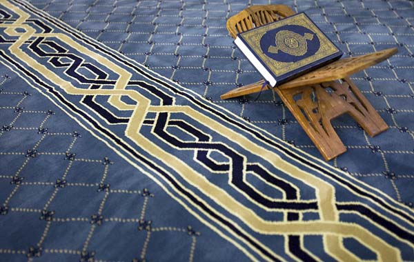 Koran on chair inside mosque.