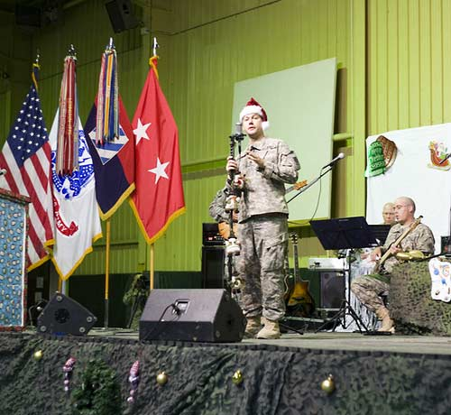 Sgt. First Class Jodie Manford and the 3rd Infantry Division Band on stage